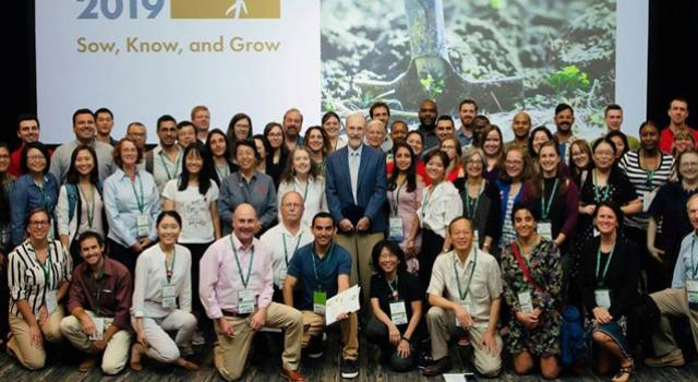 A group shot of people surrounding Larry Madden at Plant Health 2019