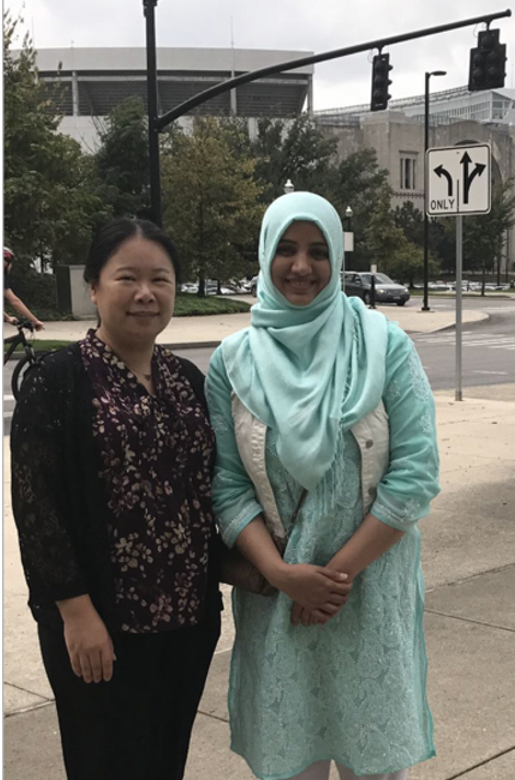 Graduate student Amna Saeed from Professor Hassan Javed Chaudhary's lab in Pakistan and OSU Assistant Professor Ye Xia at OSU Campus in USA.