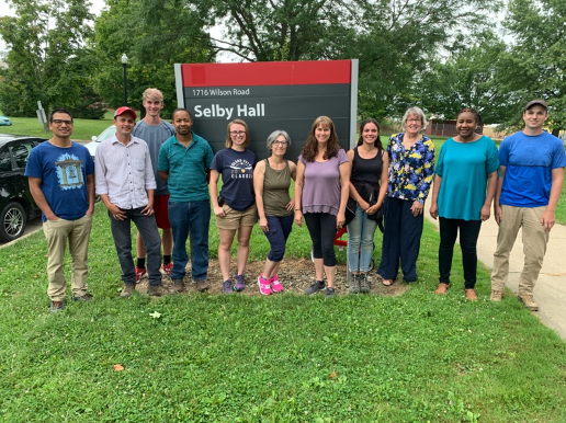2019 Miller Lab Left to right: Ram Khadka (Graduate student), Amilcar Vargas (Research Associate), Alex Taylor (Undergraduate intern), Deogracias Massawe (Graduate student), Madelyn Horvat (Research Assistant), Francesca Rotondo (Research Associate), Angie Nanes (Research Assistant),  Emma Piaget (Visiting Scholar),  Sally Miller (Professor and State Extension Specialist), Hellen Kanyagha (Graduate student), Josh Amrhein (Research Assistant)